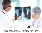 doctor reviewing x rays. doctor ... | Shutterstock . vector #120972319