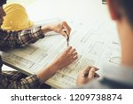 architect working on blueprint... | Shutterstock . vector #1209738874