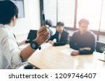 business person holding pen and ... | Shutterstock . vector #1209746407