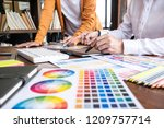 two colleague creative graphic... | Shutterstock . vector #1209757714
