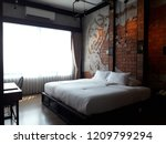 a boutique hotel is now... | Shutterstock . vector #1209799294
