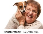 Stock photo happy attractive senior woman with puppy isolated on a white background 120981751
