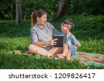 young mother teach his son to... | Shutterstock . vector #1209826417