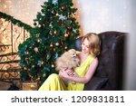 beautiful woman in a yellow... | Shutterstock . vector #1209831811