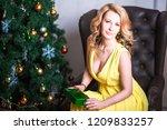 beautiful woman in a yellow... | Shutterstock . vector #1209833257