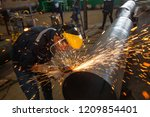 male worker wearing protective... | Shutterstock . vector #1209854401