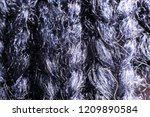knitted dark background fabric... | Shutterstock . vector #1209890584