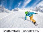 active man snowboarder riding...   Shutterstock . vector #1209891247