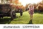 little cheerful gilr on the... | Shutterstock . vector #1209993364