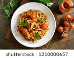 spaghetti with minced meat and... | Shutterstock . vector #1210000657