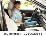 male driver fastening safety... | Shutterstock . vector #1210020961