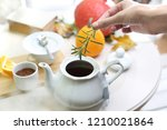tea with a sprig of rosemary. a ... | Shutterstock . vector #1210021864