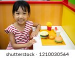 asian chinese little girl role... | Shutterstock . vector #1210030564