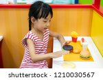 asian chinese little girl role... | Shutterstock . vector #1210030567