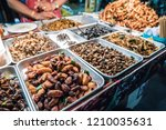 fried insects on the streets of ... | Shutterstock . vector #1210035631