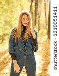 blonde woman in blue denim... | Shutterstock . vector #1210051411