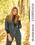 blonde woman in blue denim... | Shutterstock . vector #1210051414