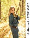 blonde woman in blue denim... | Shutterstock . vector #1210051417