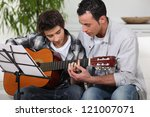 father teaching son the guitar | Shutterstock . vector #121007071