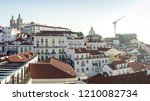 view of charming alfama during... | Shutterstock . vector #1210082734
