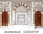 old ornate wooden doors at the... | Shutterstock . vector #121010719