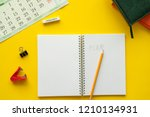 blank notebook page is on top... | Shutterstock . vector #1210134931