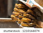 dried catfish rings on stall... | Shutterstock . vector #1210166074