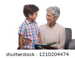 grandmother reading book to her ... | Shutterstock . vector #1210204474