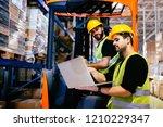 warehouse workers working... | Shutterstock . vector #1210229347