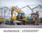 multiple cars  excavators ... | Shutterstock . vector #1210233337