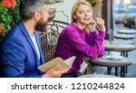 girl interested what he reading....   Shutterstock . vector #1210244824