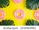 tropical palm leaves and... | Shutterstock . vector #1210303981