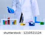 the scientist test new product... | Shutterstock . vector #1210521124