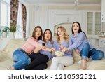 young girls watching tv  eating ...   Shutterstock . vector #1210532521