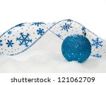 Blue Ribbon And Ornament On Th...