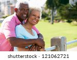 senior couple walking in park... | Shutterstock . vector #121062721
