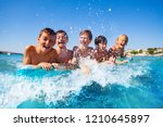 happy friends swimming in the... | Shutterstock . vector #1210645897