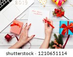 female hands writing new years... | Shutterstock . vector #1210651114