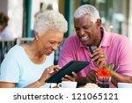 senior couple using tablet... | Shutterstock . vector #121065121