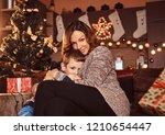 mom hugging her cute little boy ... | Shutterstock . vector #1210654447