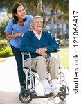 carer pushing senior man in... | Shutterstock . vector #121066417