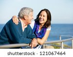 senior man with adult daughter... | Shutterstock . vector #121067464