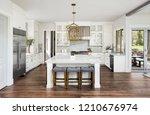 beautiful white kitchen in new... | Shutterstock . vector #1210676974
