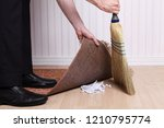 corrupt businesman sweeping... | Shutterstock . vector #1210795774