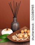 aromatherapy setting on brown background - stock photo