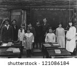 Group portrait of children standing in classroom - stock photo
