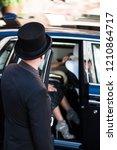hotel doorman opens luxury car... | Shutterstock . vector #1210864717