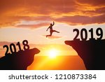 silhouette of man jumping from... | Shutterstock . vector #1210873384