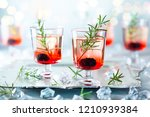 winter berry cocktails made... | Shutterstock . vector #1210939384