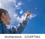 young child is playing with kite   Shutterstock . vector #121097461